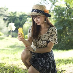 young woman using cell phone outside